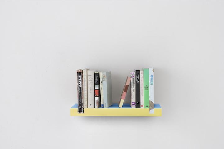Minimal Bookshelf Uses Books As Bookends