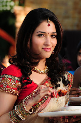 Actress Tamanna Hot Navel Show in Bed Stills