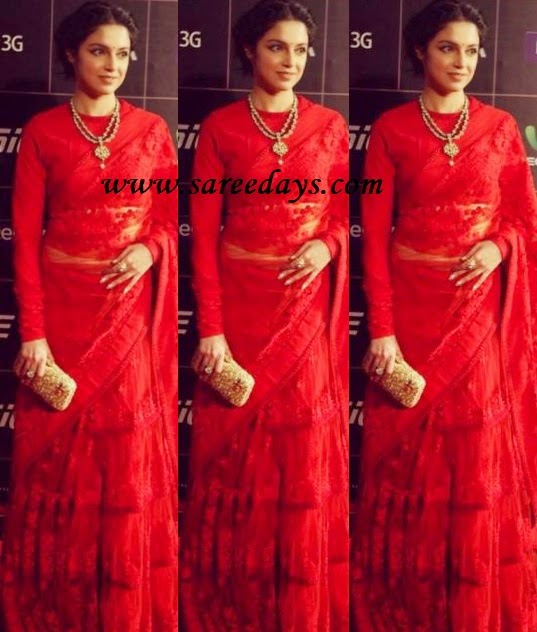 Latest saree designs divya khosla in red embroidered saree checkout divya khosla in red embroidered saree in lehenga style and paired with matching full sleeves blouse altavistaventures Images