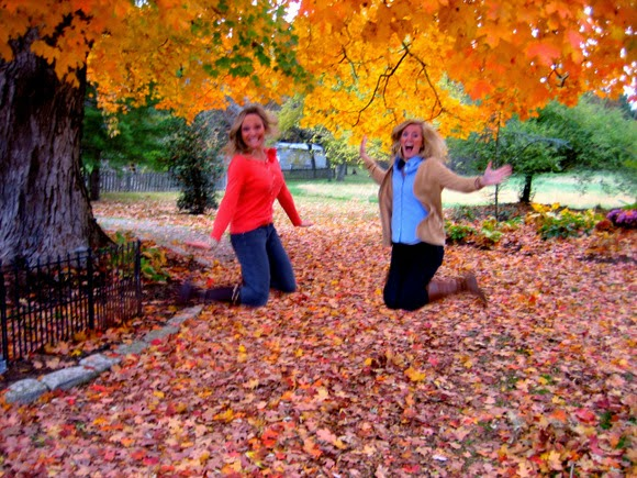 Girls jumping in leaves