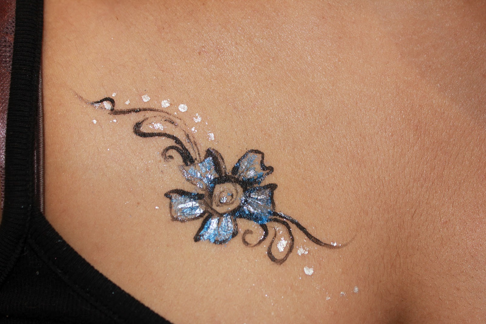 Metallic silver ink tattoos the image for Metallic tattoo ink