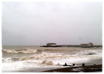 Worthing Pier in stormy sea
