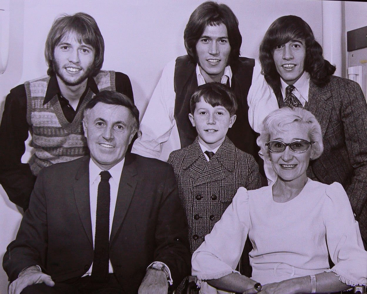 A photo of the Bee Gees (back row): Maurice, Barry and Robin Gibb, along with the rest of their family (front): Hugh, Andy and Barbara Gibb. 5 of 23Bee Gees: With age comes interesting hair. A photo of the Bee Gees (back row): Maurice, Barry and Robin Gibb, along with the rest of their family (front): Hugh, Andy and Barbara Gibb. http://www.jinglejanglejungle.net/2015/01/bgs.html
