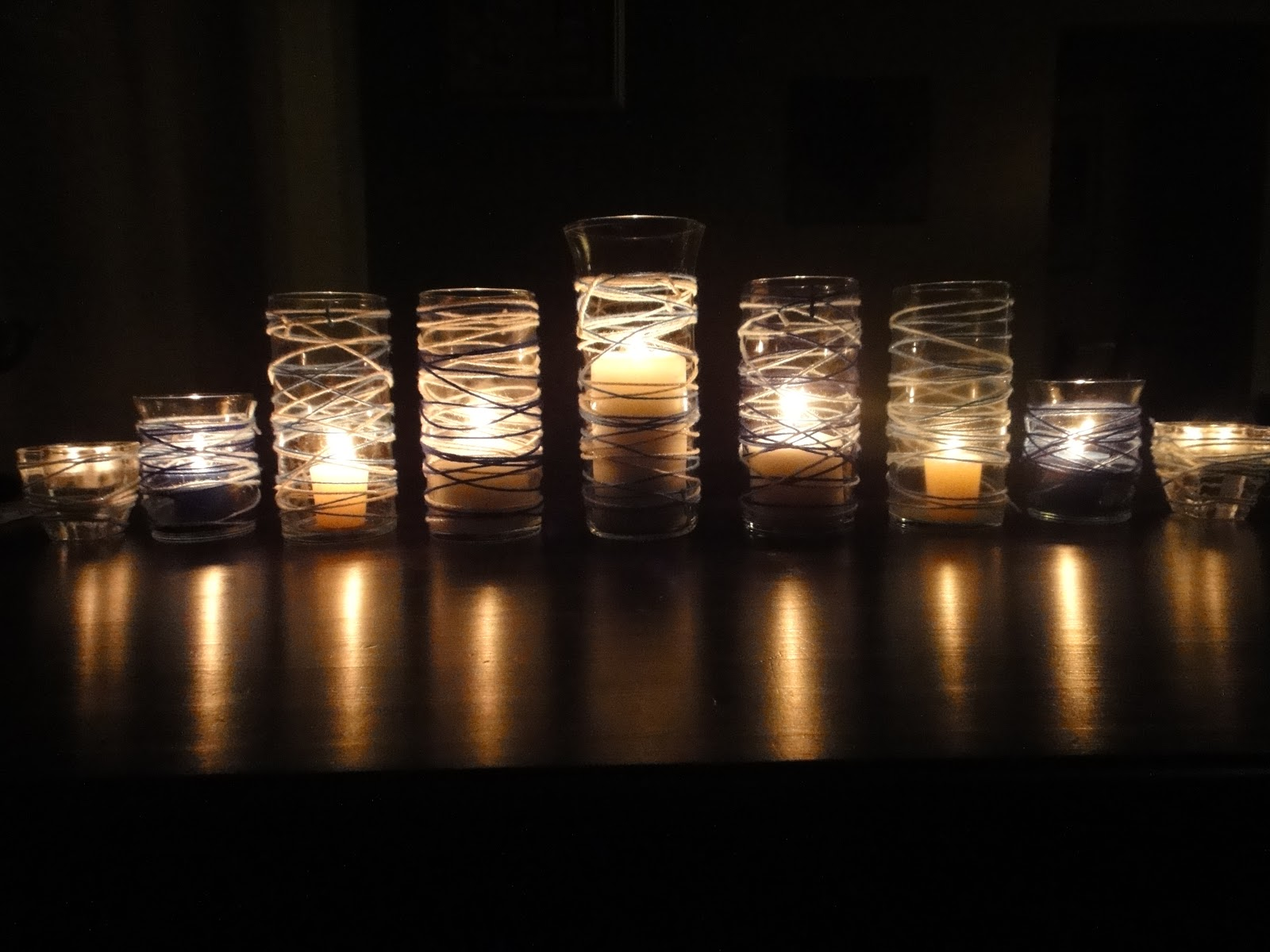 candle display for the dining room table in dramatic dark lighting - Hanukkah Decorations