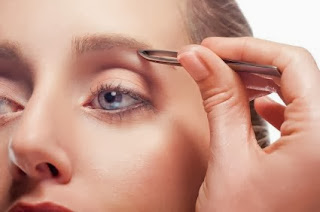 Is it haram for women to pluck, thread or modify their eyebrows ?