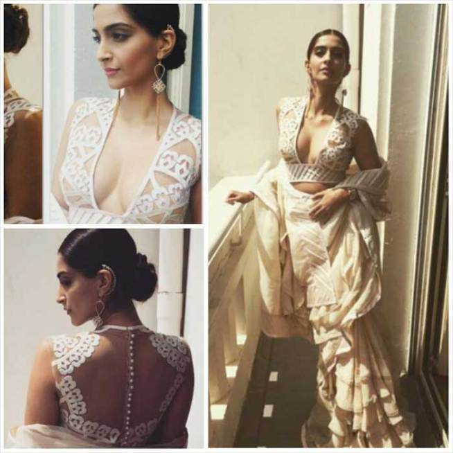 Sonam Kapoor flaunts cleavage in a low-cut sari at the 2015 Cannes Film Festival