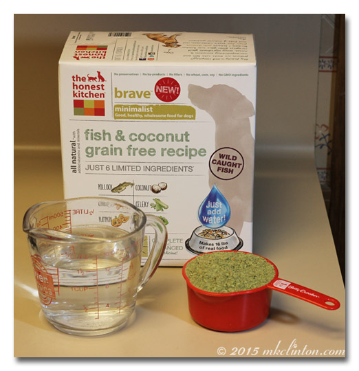 Box of THK Brave dog food, a measuring cup and a cup of dehydrated food
