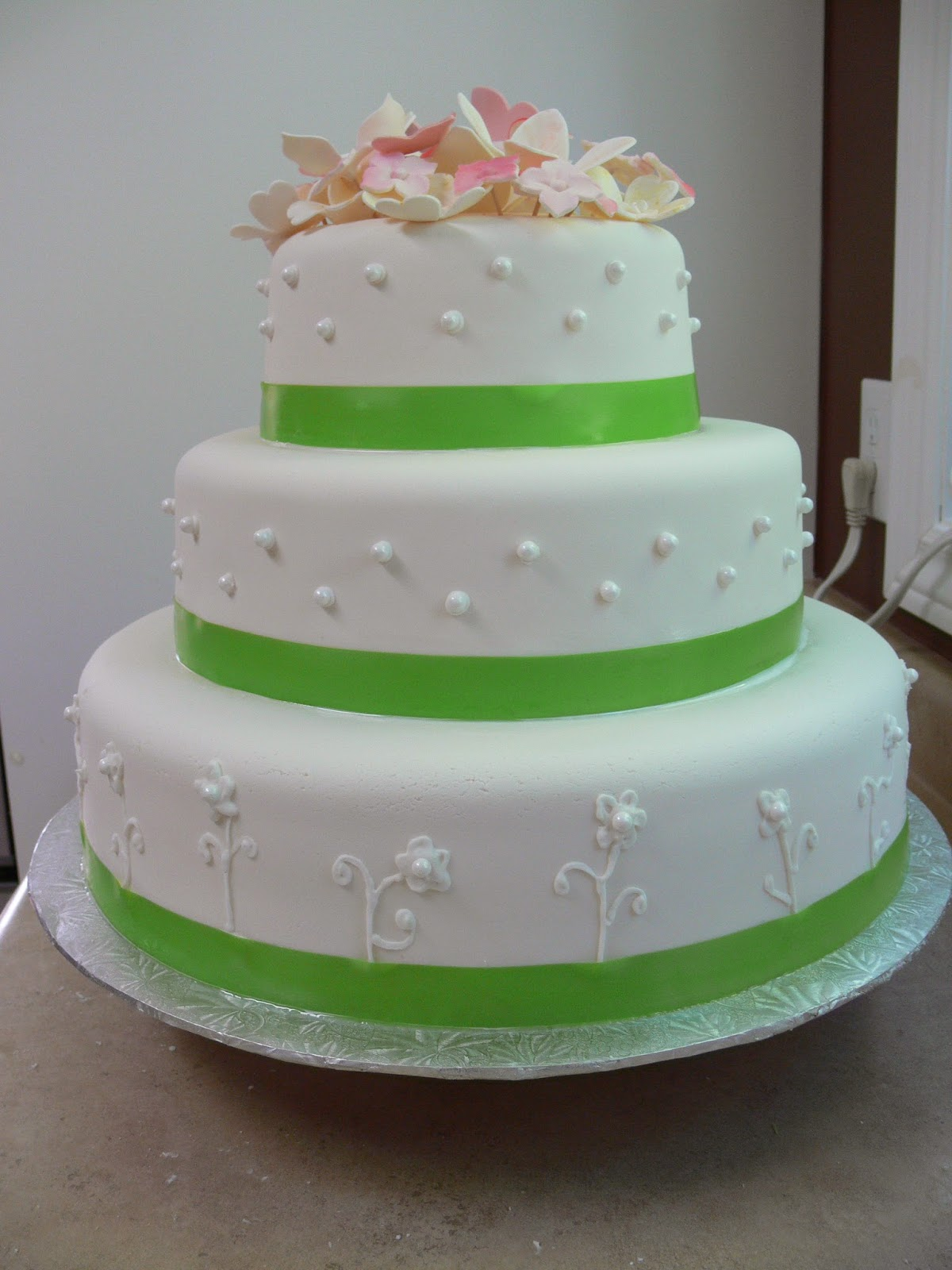 Spring Wedding Cake With Pink Flowers Candy Pearls And Green Ribbon