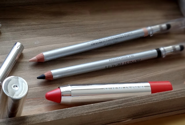 Honest Beauty Truly Kissable Sheer Lip Crayon in Petal Kiss, True Velvet Eyeliners in Truly Black, Eye Opener