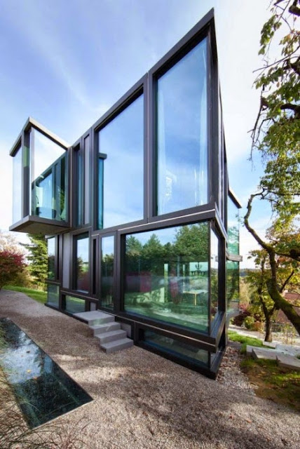 TOP 7 UNIQUE HOUSE DESIGN: ULTRAMODERN ANGULAR GLASS HOUSE DESIGN FOR A STEEP PLOT IN ZURICH WITH TRANSPARENT EXTERIOR WALLS