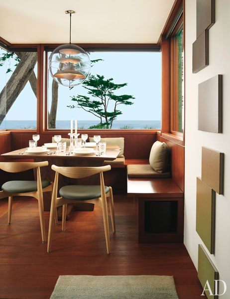 A View Of The Ocean From Breakfast Room Verner Pantons Acrylic Globe Light Hangs Above Hans Wegner CH20 Elbow Chairs And Marie Krane Bergman