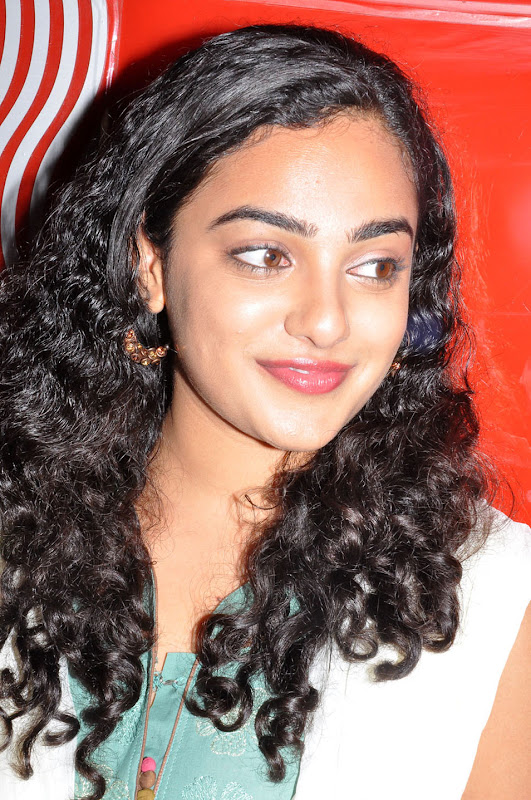 Nithaya menon Cute Stills in  tamil Movie Press meet new Photos hot photos