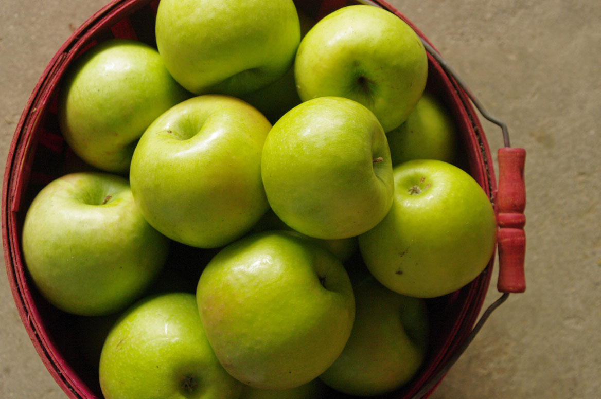 green and red apples in basket. green apples, red basket and apples in l