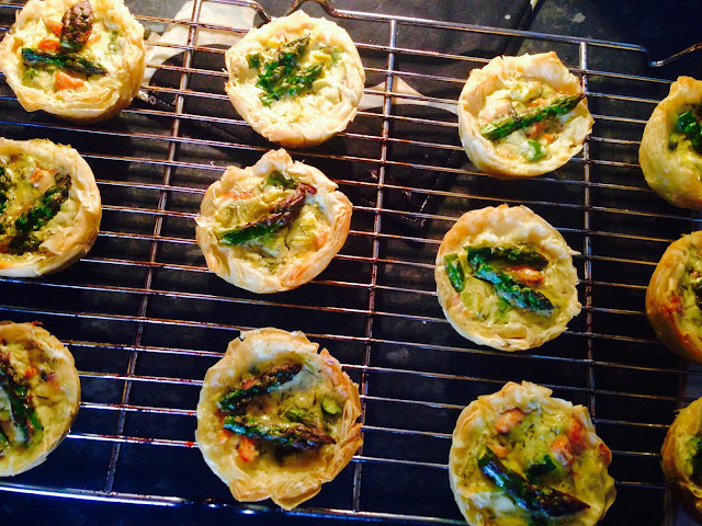 Salmon, feta and asparagus fillo tartlets fresh from the oven