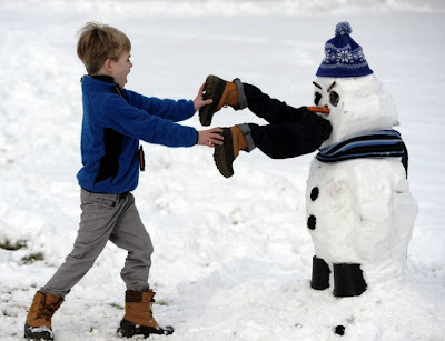Snowman eating a child