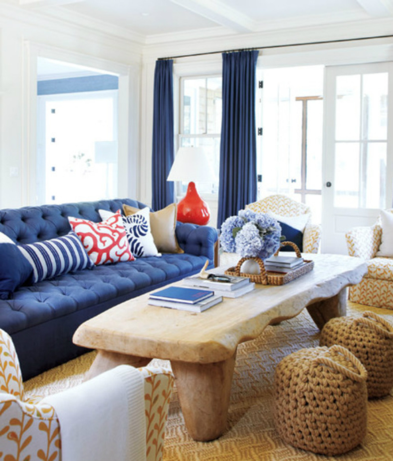 living room is framed with navy draperies and anchored with a navy