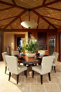 Unusual Ceiling above the Round Dining Tables and some Grey Chairs on the Brown Stone Floor
