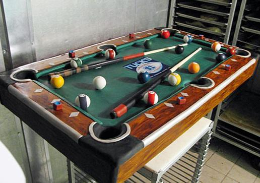Buddy created this lookstoorealtobeacake cake for a billiard