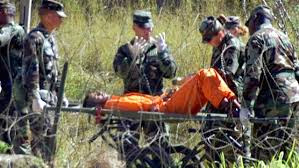 Hunger striker being taken away on guerney at Guantanamo Bay