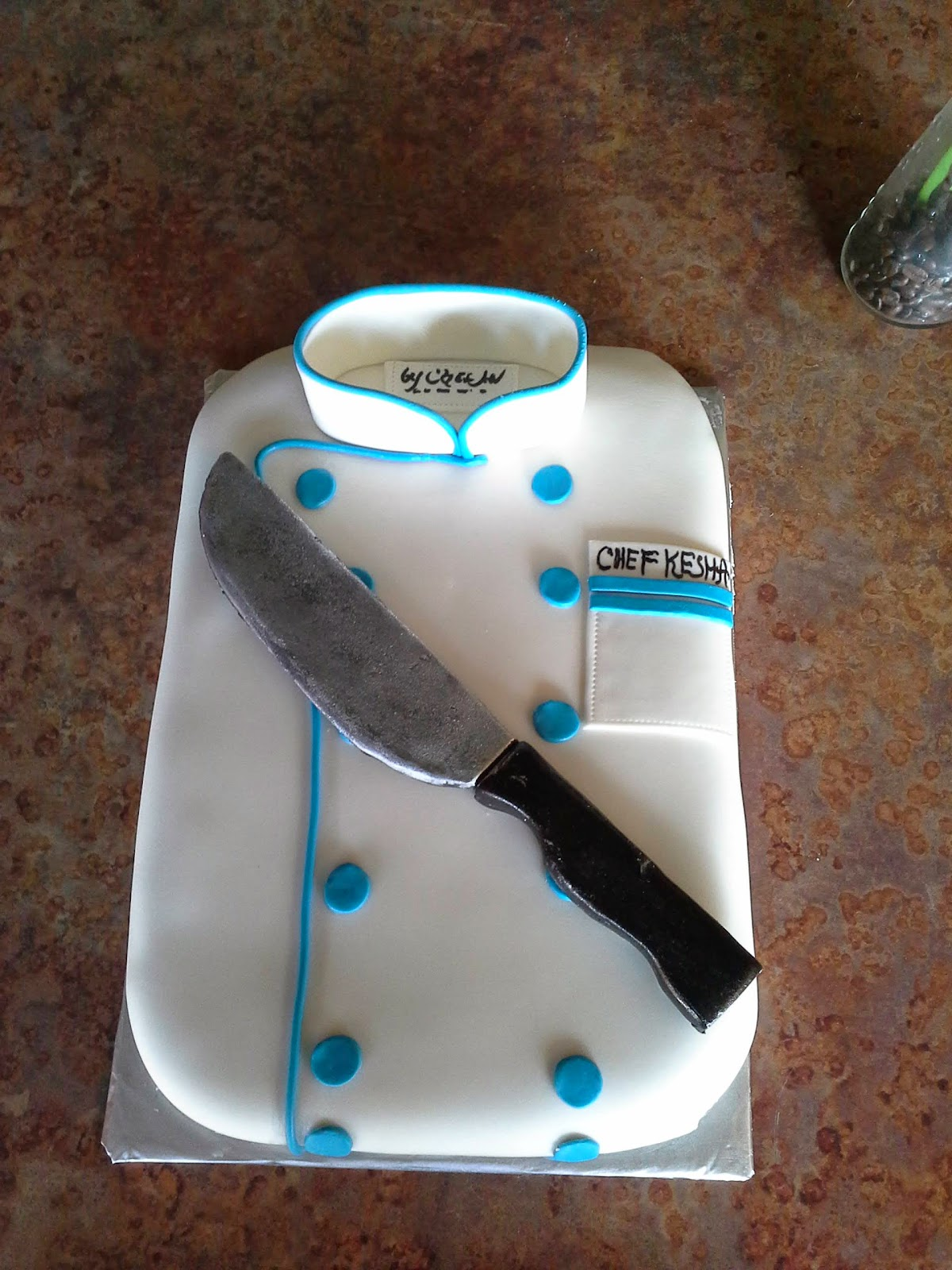 CAFE AROMAS: Chef Coat with Knife Cake