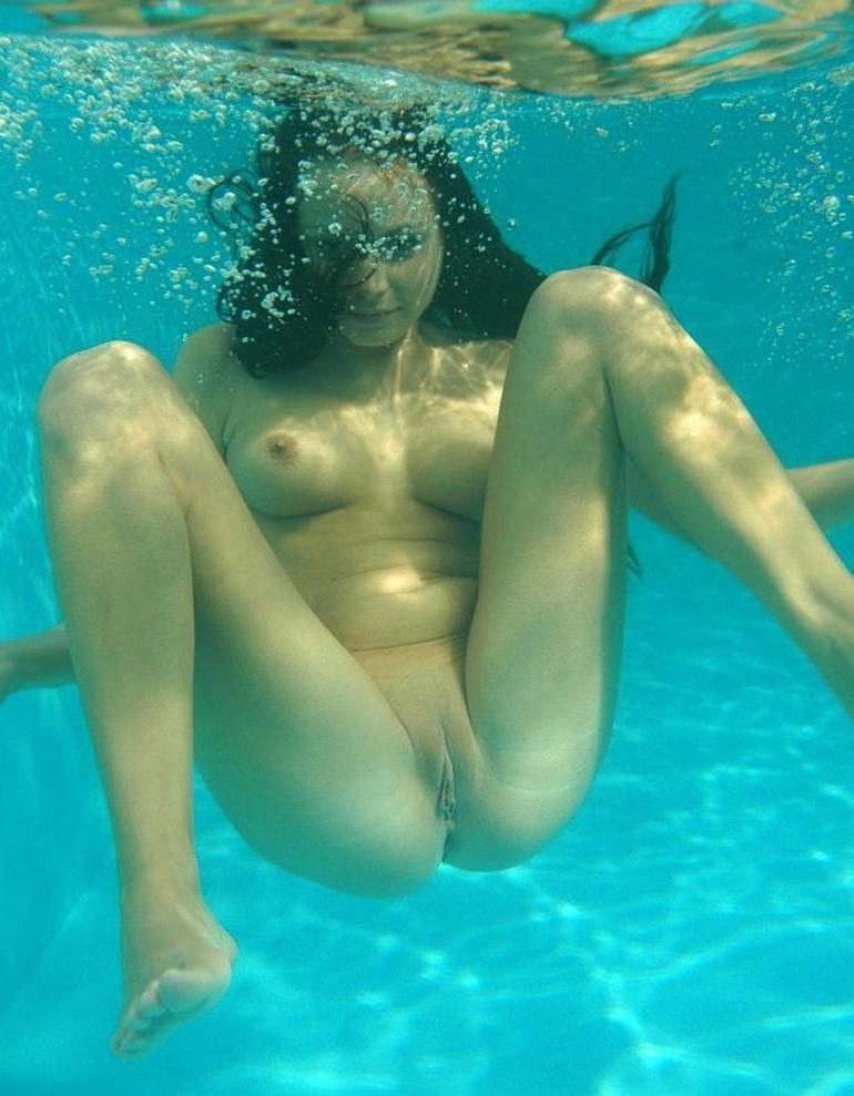 Women naked in a pool