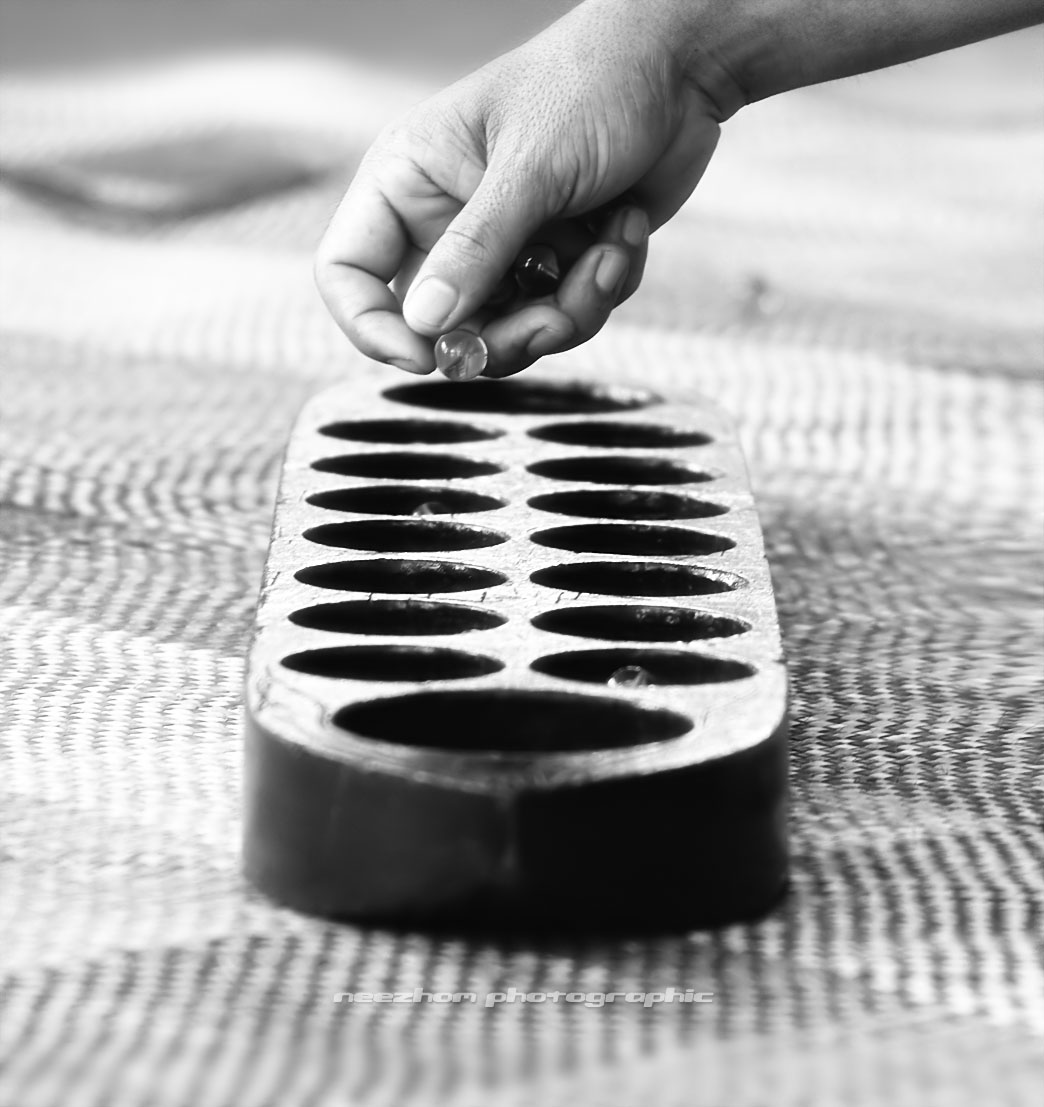 Congkak or Congklak is a mancala game of Malay origin played in Malaysia,  Singapore, Brunei, Southern Thailand, and some parts of Sumatra and Borneo.