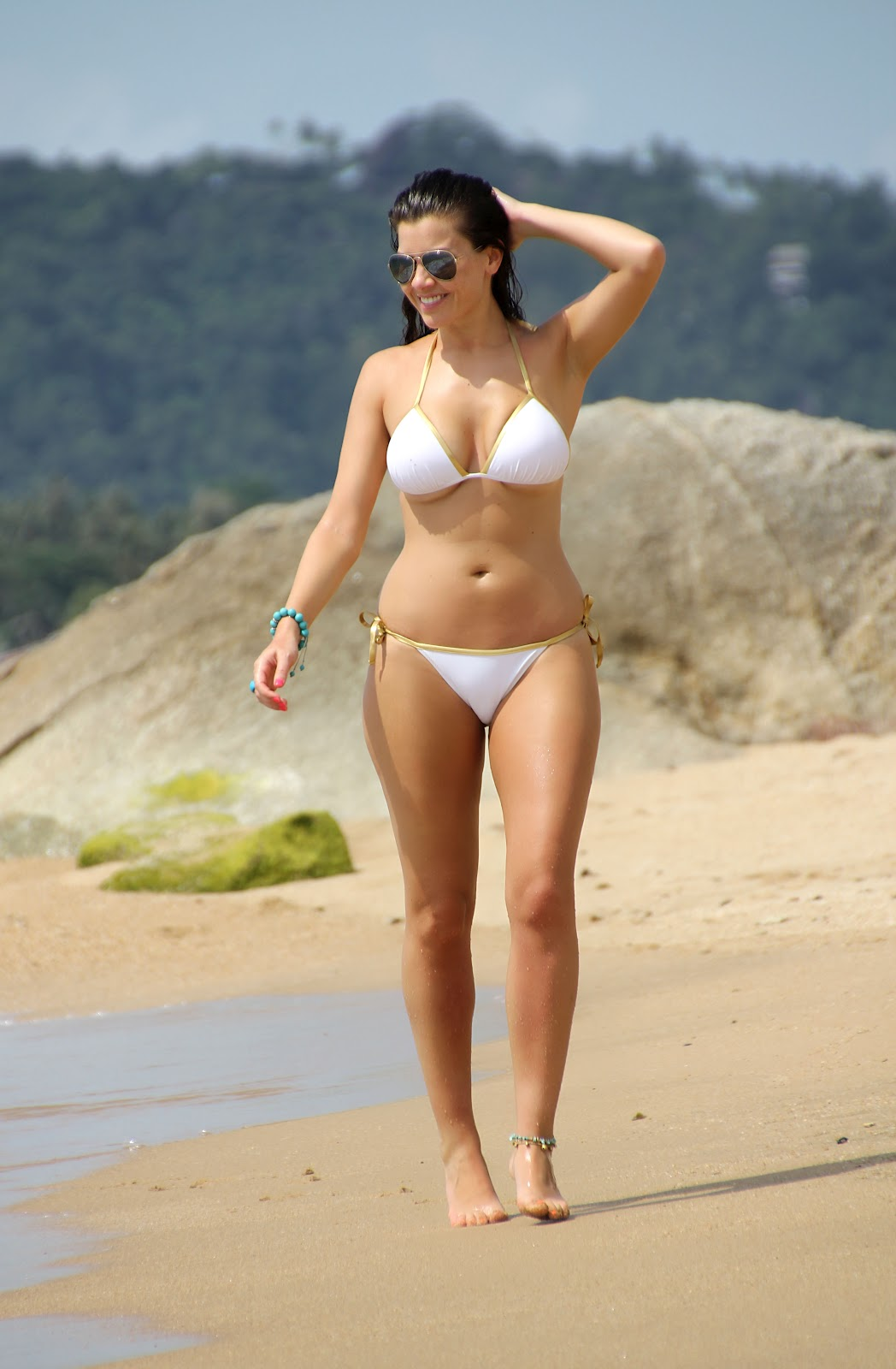 With her slim body and Dark brown hairtype without bra (cup size 36E) on the beach in bikini