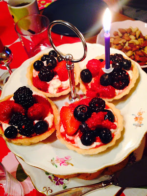 Tartlets with amaretto soaked berries and cream