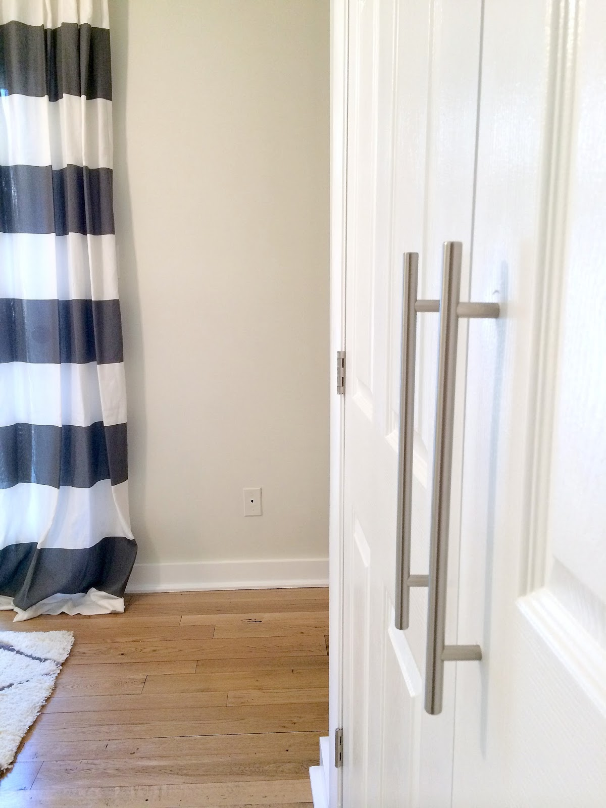 DIY Closet Door Update: How to update your old bi-fold doors to modern french doors! Love the little added touch of the door pulls, too. Such an easy update! So glad I found this!