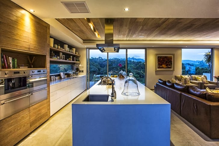 Kitchen in Modern Mansion by Metropole Architects