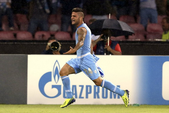 Napoli player Lorenzo Insigne celebrates after scoring against Borussia Dortmund