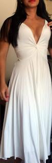 Brunette blogger in white plunging neckline dress
