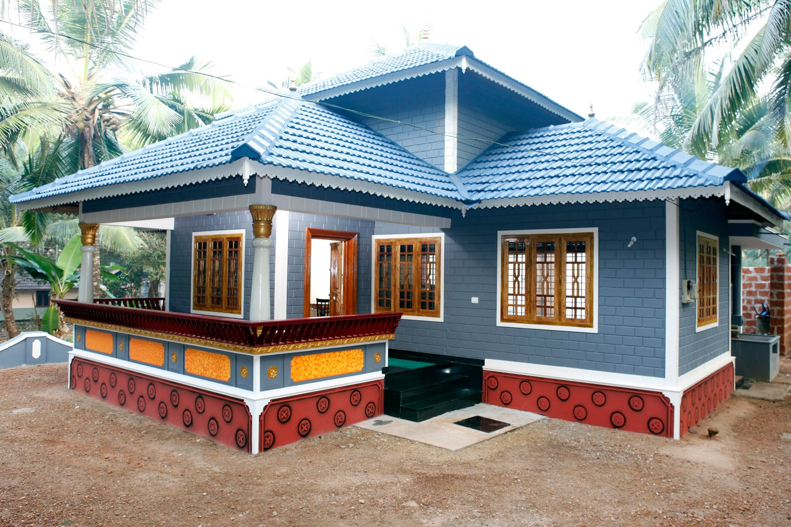 Building designers gallery for Low cost kerala veedu plans