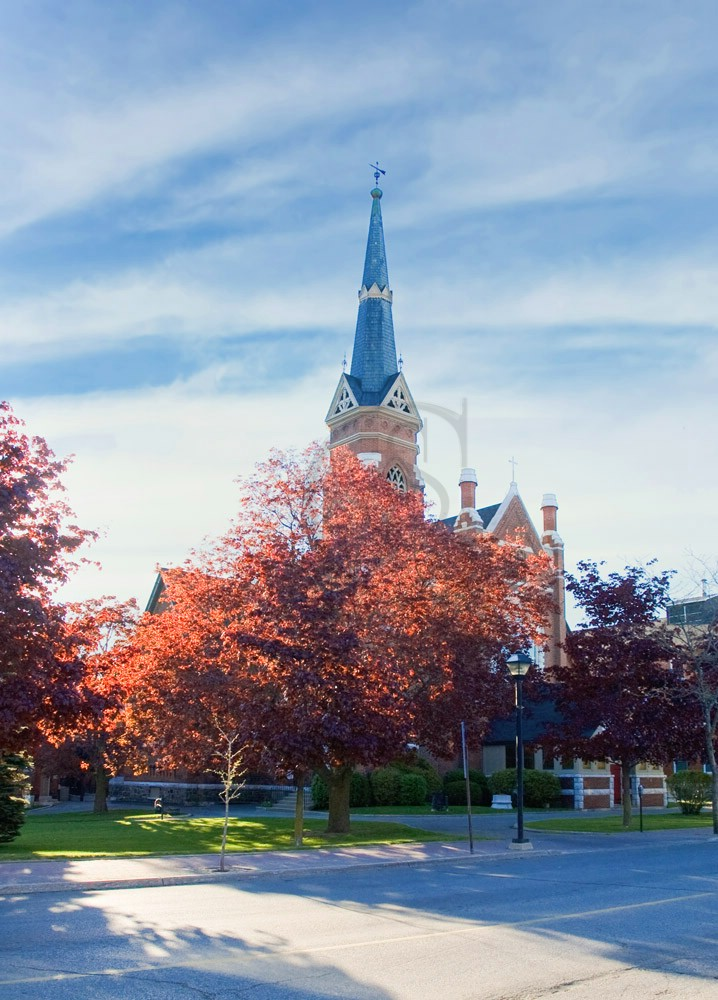 St. James' Anglican Church in downtown Orillia; on an autumn morning the church itself is all but obscured by the colourful trees, with it's tall spire splitting the morning sky.