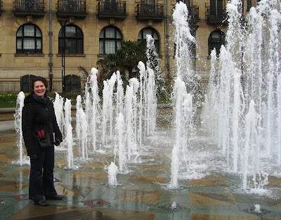 Lola II standing next to a fountain