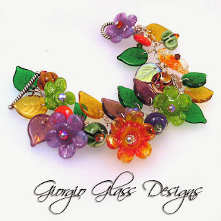 https://www.etsy.com/listing/150458289/lampwork-bead-flower-blossoms-bracelet?ref=shop_home_active