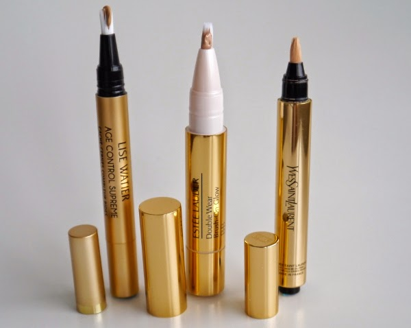 Gold brush-tip concealer pens similar to YSL's Touche Eclat from Lise Watier and Estee Lauder