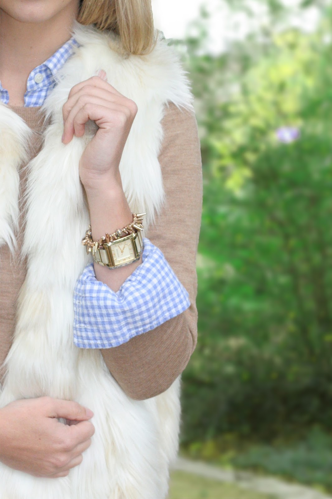 fall-and-winter-layers-a-fur-vest-and-sweater-with-a-bracelet-stack