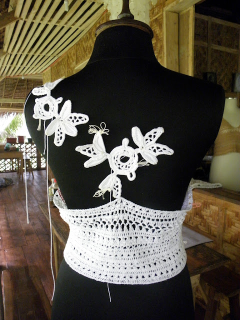 Shaping a garment with Irish crochet lace motifs.
