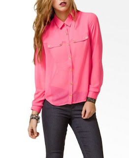 A shot of a model wearing a neon pink shirt