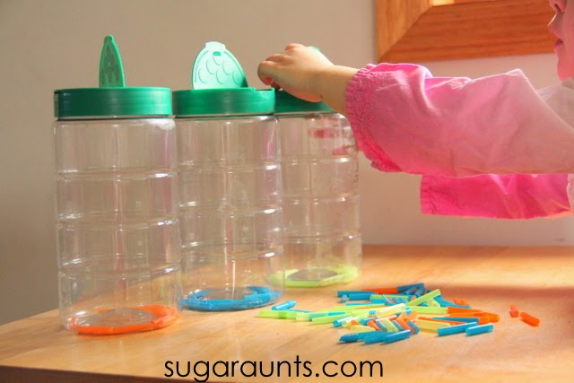 Use colored straws to sort and work on fine motor skills with recycled containers.