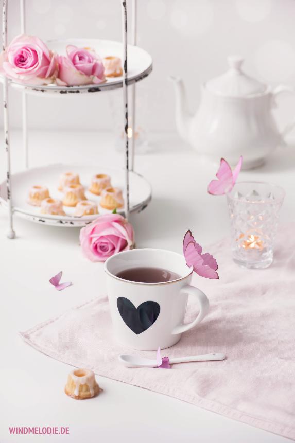 rosa teatime rosen schmetterlinge aus papier weiße etagere