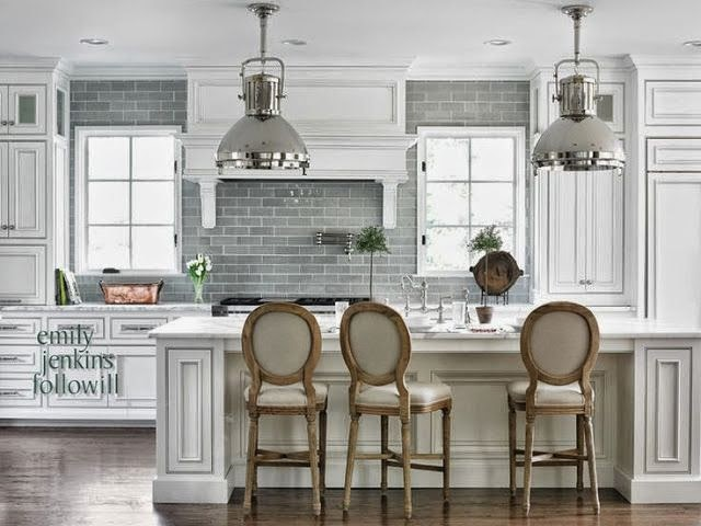 beautiful traditional white kitchen with gray subway tile dark hardwood floors silver pendant lights