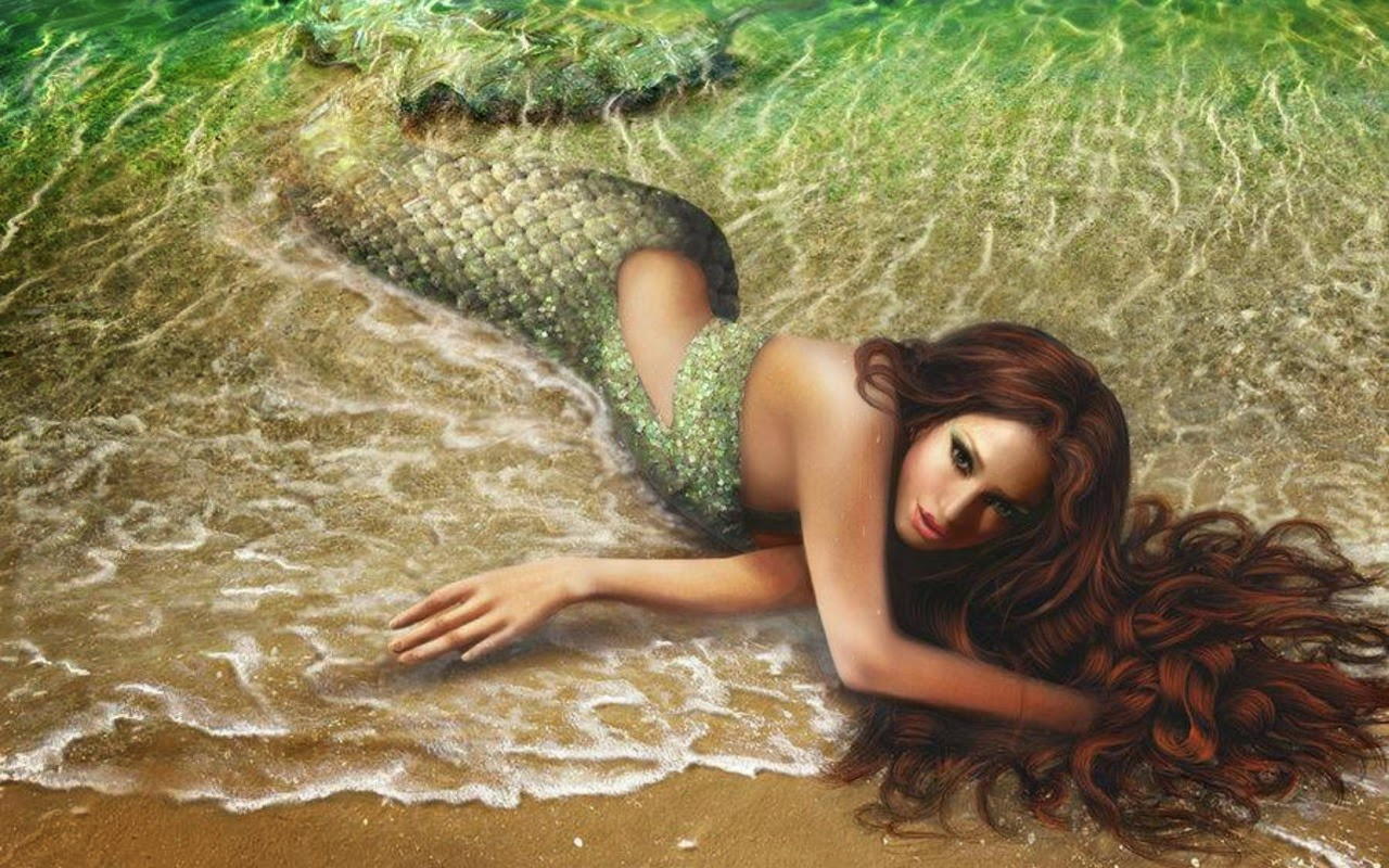 real-life-mermaid-girl-on-beach-costume-green-photo.jpg