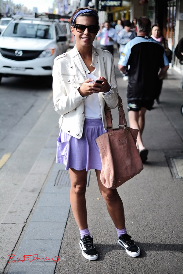 Street Style, mauve skirt in stretch cotton teamed with a white Tee and white leather jacket, black Velcro-lace skate shoes on the bottome tied and teamed with a mauve hair-band and black Ray Ban Wayfarer sunglasses