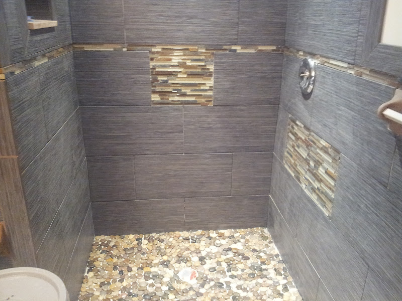 Glass tile, river stone and porcelain tile shower installed in Margate  title=