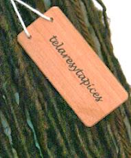 Etiqueta de los telares impresa en madera de Raulí