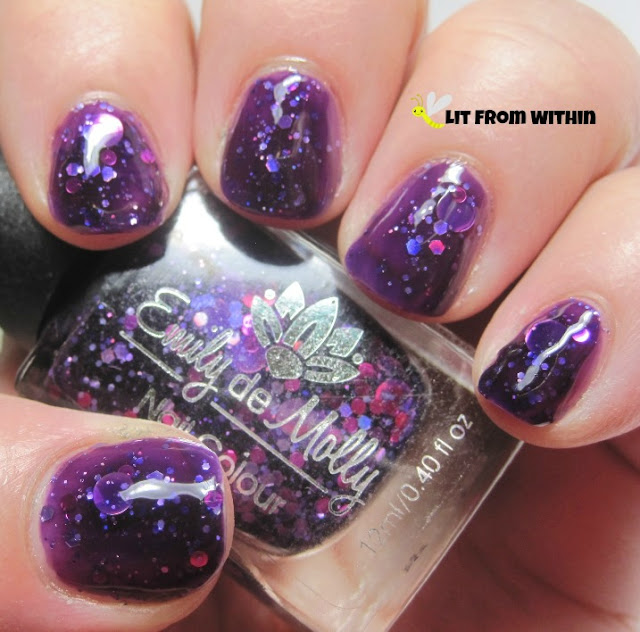 Cosmic Forces is a dark purple jelly with pink and purple and holo glitters
