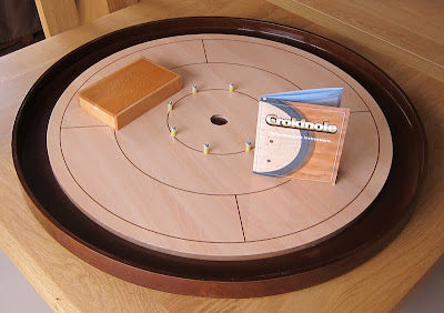 Crokinole - The large game board sitting on the end of the dinner table