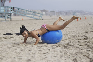 Bai Ling exercising on the Beach wearing a bikini